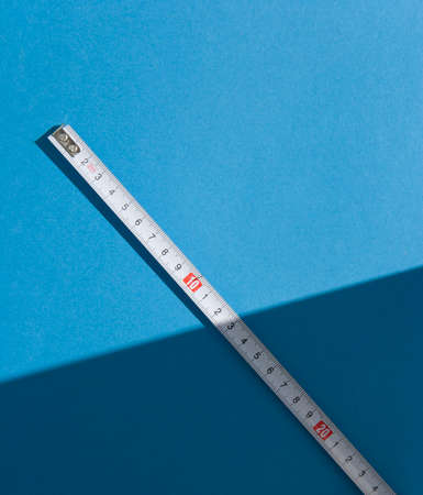 Tape Measure on light blue background. photo