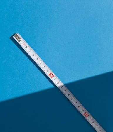 Tape Measure on light blue background. photo