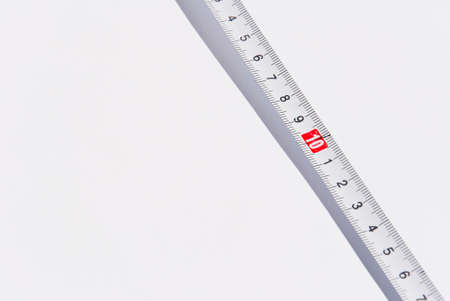 Tape Measure on light grey background. photo