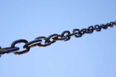 prison break: Chain on blue background. Selective focus Stock Photo