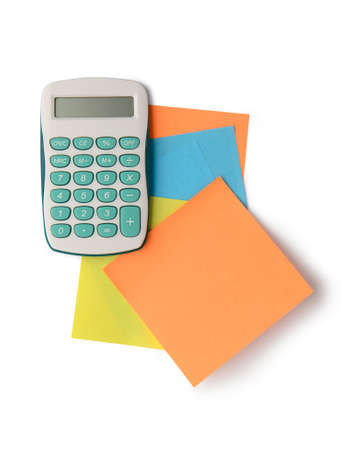 Calculator and adhesive notes isolated on white background with clipping path. Above view. photo