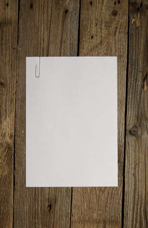 Blank paper on dark wood background. Above view. photo