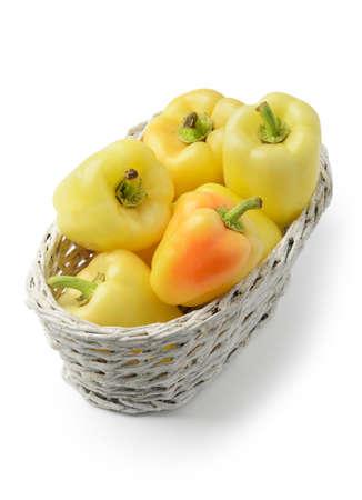 basketful: Yellow bell peppers is a basket isolated on white background
