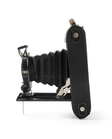 bellows: Vintage bellows photo camera isolated on white background. Side view. Stock Photo