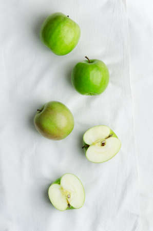 apple green: Green apples over white cloth, above view