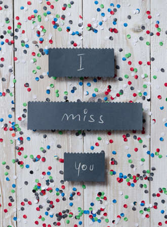 i miss you: Handwritten card with I miss you text over white table