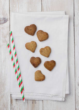 tabel: Homemade heart shaped cookies over white cloth Stock Photo