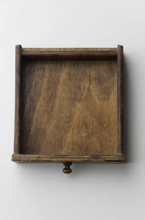 Wooden drawer or box over white background, top view 版權商用圖片