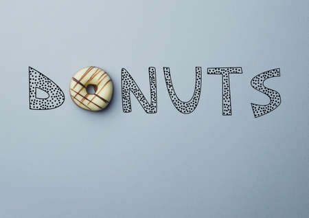 doodle text: Donut with a doodle text Donuts concept