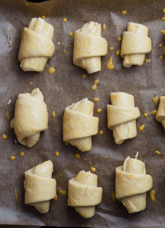mini oven: Mini croissants with cheese prepared for baking. This image is part of a large series.