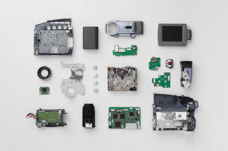 deconstruct: Parts of a mini DV video camera separate and well arranged over white background, above view Stock Photo