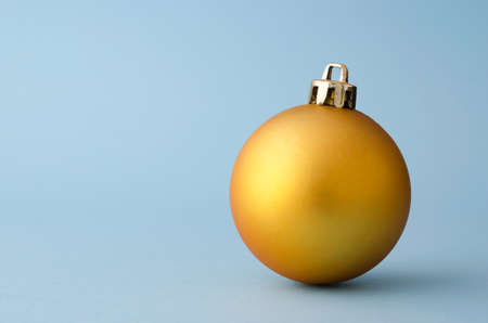 blue gold: Single Golden Christmas Ball over blue background with copy space for text or other design Stock Photo