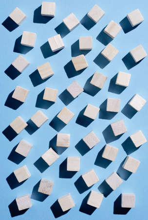 black blue: Wooden cubes spread over blue background, top view