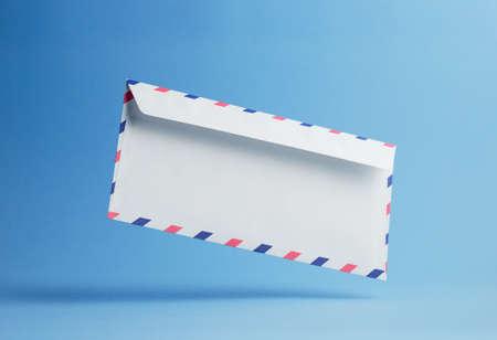 par avion: Envelope falling on the ground, blue background