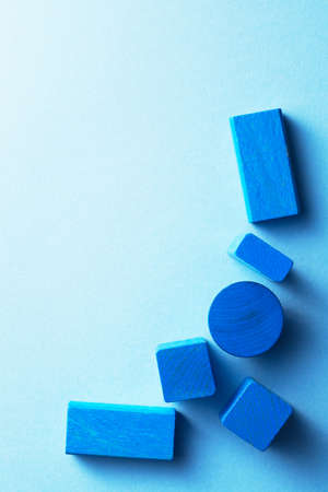 negative space: Blue wooden cubes over blue background, top view with negative space