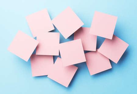 disorganized: Paper squares disorganized over blue background, top view Stock Photo