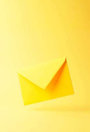 dropped: Yellow envelope dropped over yellow background