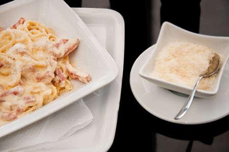 Spaghetti carbonara with bacon and parmezan photo