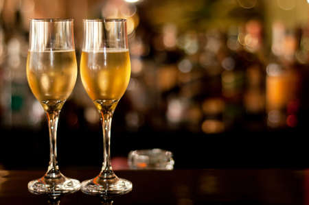 Two glasses of champagne waiting to be served by guests in a resturant, new year's eve.