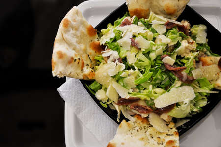 Close up view of a formaggi salad with ham and toast photo