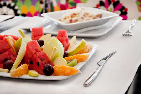 stracchino: Fruit salad with Carbonara background Stock Photo
