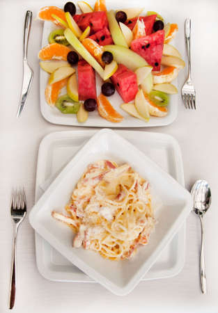 lunch with spaghetti carbonara and fruits photo