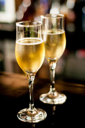 warm drink: 2 champagne glasses on bar background Stock Photo