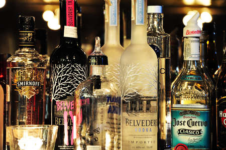 Bottles of different kind of drinks at a bar