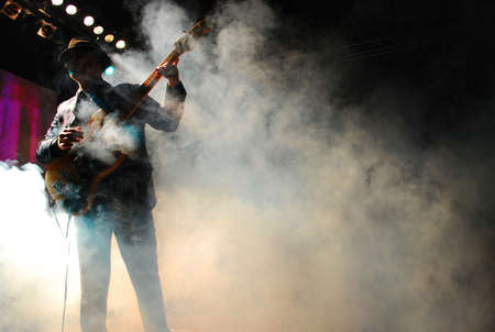 silhouette of a guitarist playing live