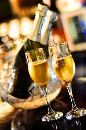 Isolated glasses of champagne and bottles, saturated photo