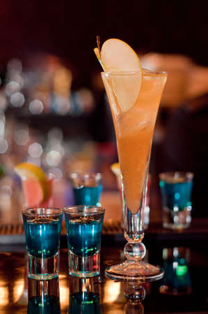 Apple exotic cocktail with blue curacao shots photo