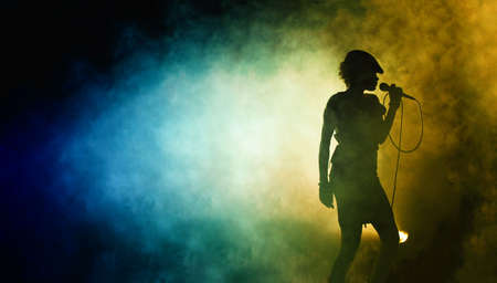 Live  Singing woman silhouette with blue smoke background  photo