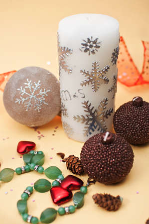 Christmas decorations with three candles and elements photo