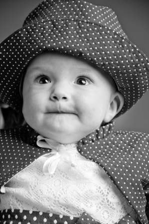 Black and white portrait of a seven months old adorable baby photo