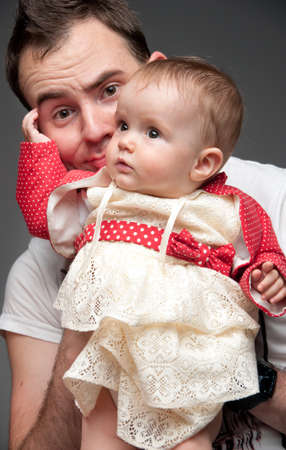 Young father learning how to take care of an adorable little infant. Concept photo