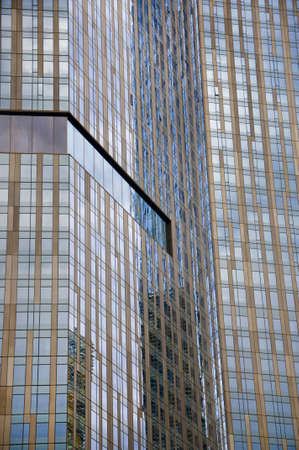 building color: abstract modern glass building detail background, with sky color reflection
