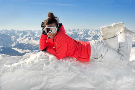 Female skier on top of european alps with mountain background photo
