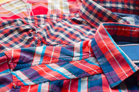 Close up of three red, colorful shirts  photo