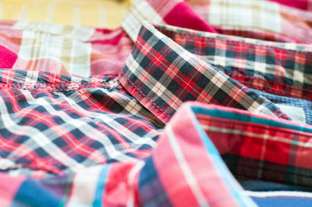 Colorful shirts on shelf in clothing store photo