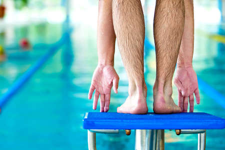 start swimming race concept with male swimmer in swimming pool photo