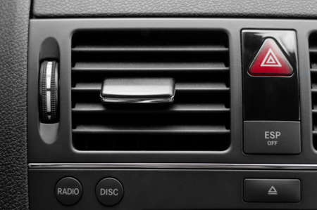 agreeable: Car ventilation system with severl buttons and details of modern car