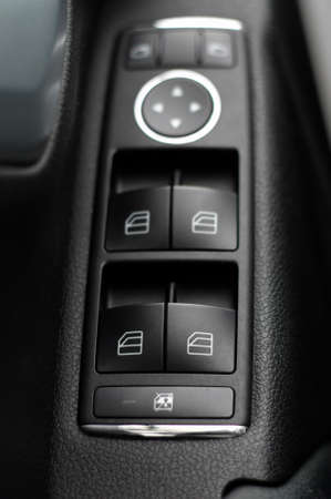 switch on: Window  and mirror control panel on drivers door, detail of modern car