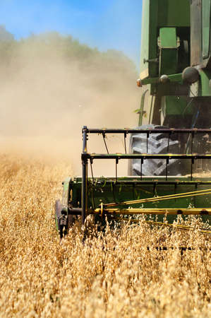 Combine harvesting machinery collecting wheat from the fields Stock Photo - 14739208