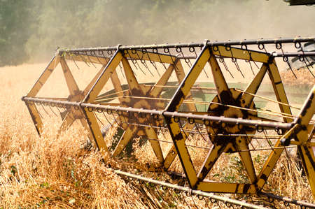 Closeup of harvesting machinery detail while working the field Stock Photo - 14739214