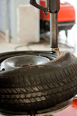 Wheel repair in auto service garage photo