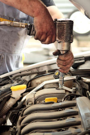 high torque: Auto mechanic engineer working on car engine