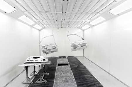 bodywork: Car doors hanging inside a car paint box Stock Photo