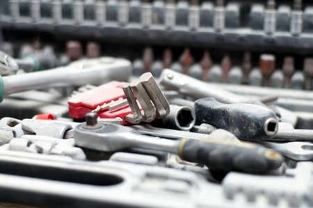 kit of adjustable metallic tools with mechanical background Stock Photo - 17167629