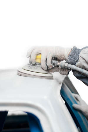 mechanic prepairing the body of a race car for painting Stock Photo