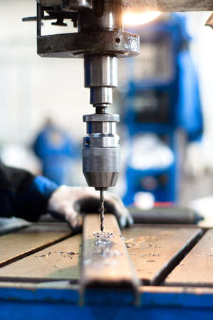 industrial worker using a mechanical drill machine photo